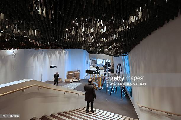People walk inside the new Philharmonie de Paris on January 13 2015 ahead of its opening in Paris The Philharmonie de Paris opens on January 14 in...