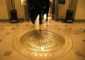 People walk into a meeting of the Board of Governors at the Federal Reserve October 24 2013 in Washington DC The Board of Governors of the Federal...