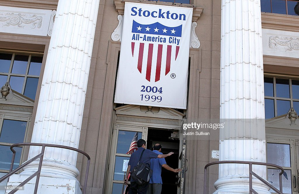 People walk into Stockton City Hall on June 27, 2012 in Stockton, California. Members of the Stockton city council voted 6-1 on Tuesday to adopt a spending plan for operating under Chapter 9 bankruptcy protection following failed talks with bondholders and labor unions failed. The move will make Stockton the biggest U.S. city to file for bankruptcy protection from creditors.