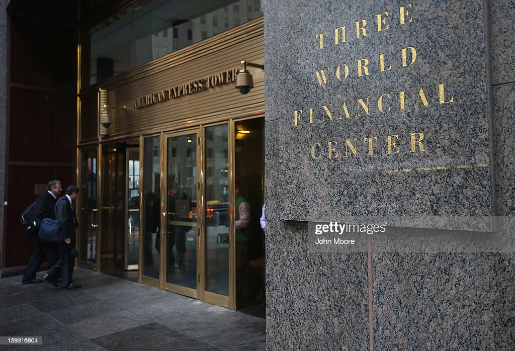 People walk into the American Express Tower at the World Financial Center on January 11, 2013 in New York, New York. Following low fourth quarter earnings, American Express announced plans to cut 5,400 jobs in the coming year.