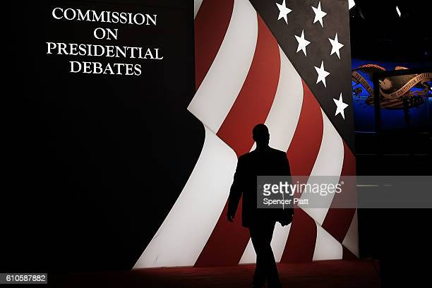 People walk into the debate hall at Hofstra University hours before the official programming begins on September 26 2016 in Hempstead New York...