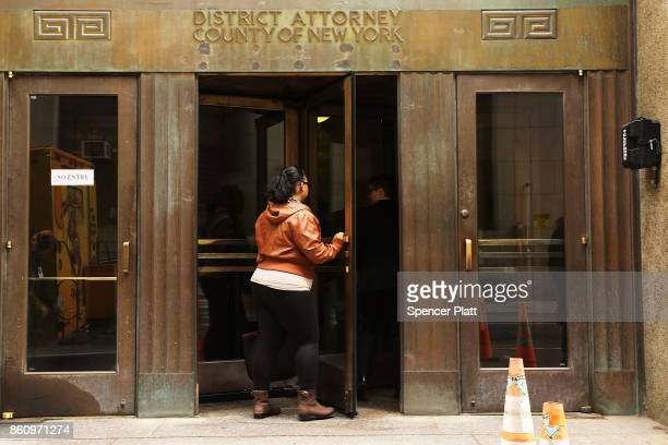 People walk into the Manhattan District Attorney's office on October 13 2017 in New York City Cyrus R Vance Jr the Manhattan district attorney has...