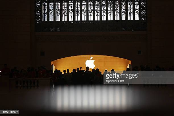 People walk into the new Apple store in Grand Central Station on December 9 2011 in New York City The store which opened to the public today...
