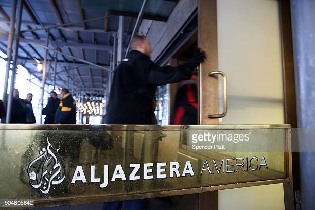 People walk into the offices of Al Jazeera America a cable news channel that debuted in August 2013 on January 13 2016 in New York City Al Jazeera...