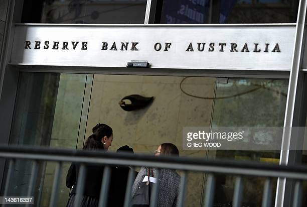 People walk into the Reserve Bank of Australia building in central Sydney on May 1 2012 Australia's central bank slashed interest rates by a shock 50...