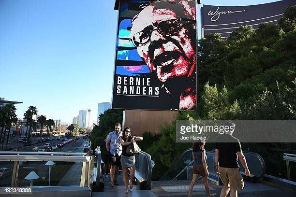 People walk near a billboard with a picture of Democratic Presidential candidate Bernie Sanders advertising the upcoming Democratic Presidential...