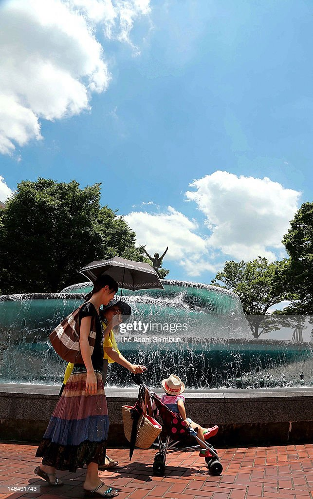 People walk near a fountain under the hot weather on July 17, 2012 in Nagoya, Aichi, Japan. Japan Meteorological Agency announced that the rainy season seems finish in most of the area in Japan.