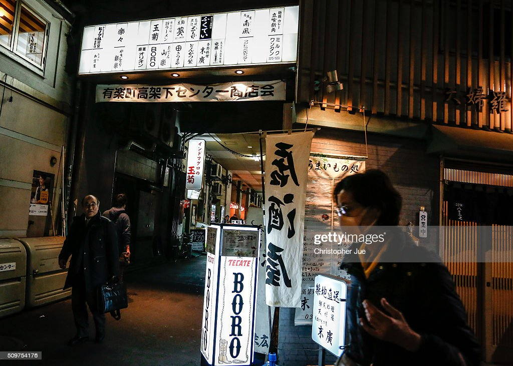 People walk near a small alley way of restaurants in downtown Tokyo on February 12, 2016 in Tokyo, Japan. The Nikkei Stock Average finished 11% down for the week, its biggest weekly drop since October 2008, and the index for the day ended 4.8% down, the lowest since October 2014.