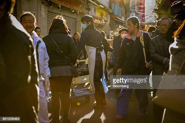People walk near a Sushi Zanmai restaurant in Tokyo Japan on Thursday Jan 5 2017 Kiyomura KK operator of Sushi Zanmai restaurant made the winning bid...