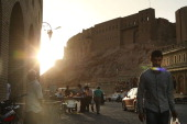People walk near the Citadel in Erbil on June 29 2014 in Erbil Iraq Tens of thousands of displaced Iraqis and Syrians have converged on the ancient...