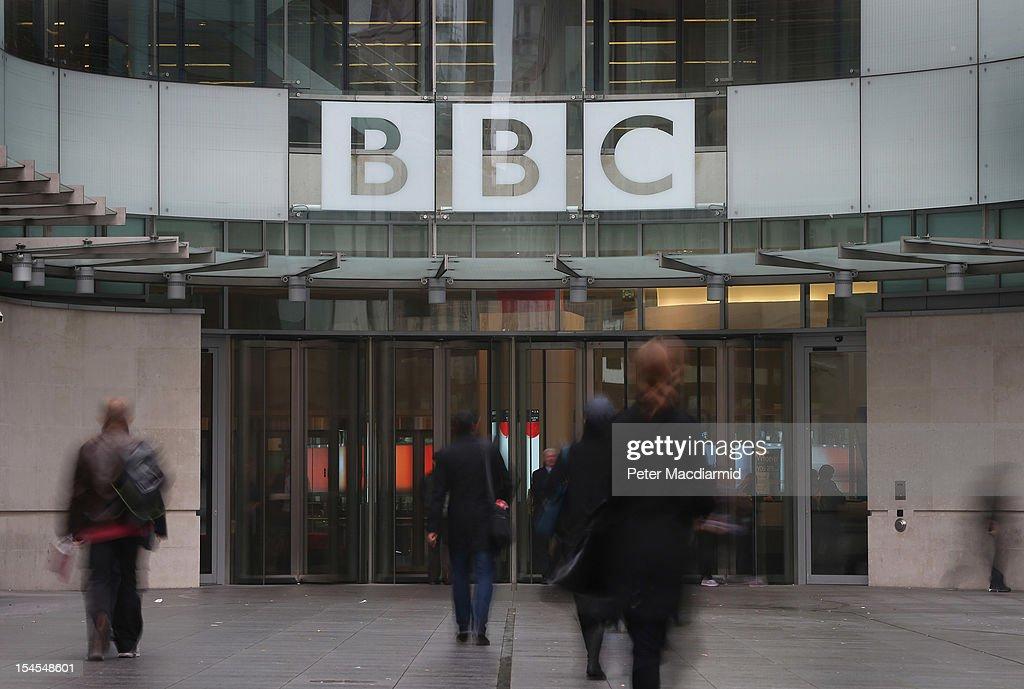 People walk near the entrance to BBC Broadcasting House on October 22 2012 in London England A BBC1 'Panorama' documentary to be broadcast later...