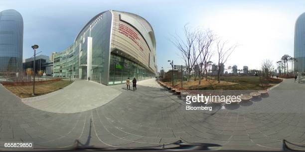 People walk near the Lotte Corp World Tower in Seoul South Korea on Monday March 13 2017 After almost seven years of planning and 4 trillion won in...
