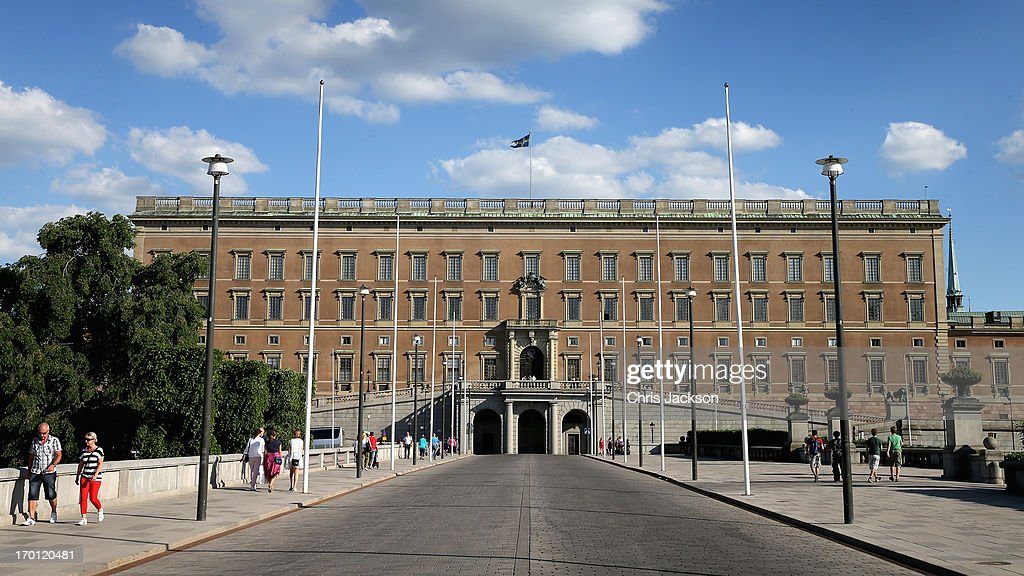 People walk near the Royal Palace as preparations for the wedding of Princess Madeleine of Sweden and Christopher O'Neill continues on June 7, 2013 in Stockholm, Sweden.