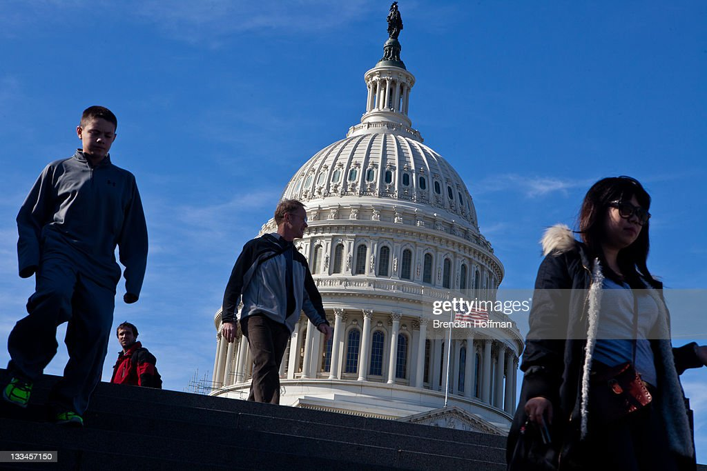 People walk near the U.S. Capitol on November 19, 2011 in Washington, DC. The Joint Select Committee on Deficit Reduction, or super committee, which faces a Wednesday deadline to reach a deficit reduction agreement, planned to meet over the weekend.