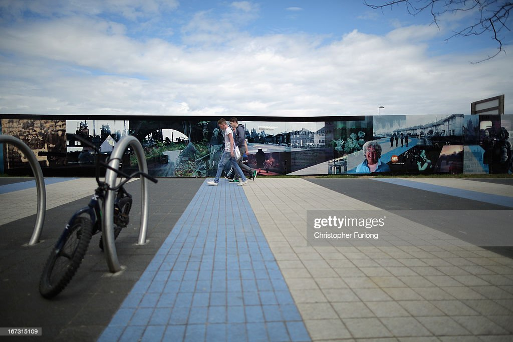 People walk near walls displaying imagery in Northamptonshire, the youth unemployment capital of Britain, on April 24, 2013 in Corby, England. A recent study pin pointed Corby as Britain's youth unemployment capital. The study by education specialists Ambitious Minds found that youth unemployment was 11% rising from 4% in 2007. Corby in Northamptonshire was built around its steel industry in the 1930's. The steel works closed in 1980 with the loss of 10,000 jobs.