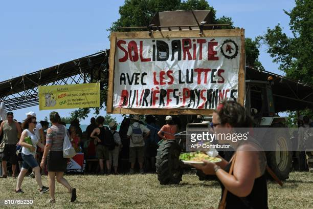 People walk next a banner reading 'Solidarity with worker and peasant struggles' during a twoday meeting organised by opponents to a controversial...