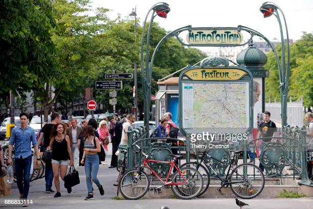 People walk next to the entrance of the metro station 'Pasteur' on May 22 2017 in Paris France The entrance to this subway station was designed by...
