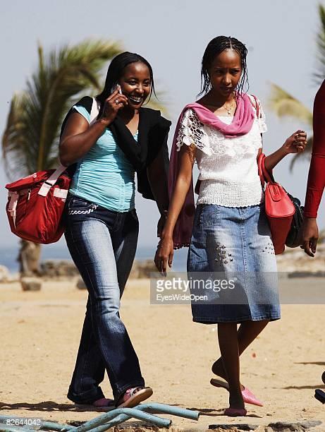 People walk on a beach on the Ile De Gore island on December 27 2007 in Dakar Republic of Senegal The Ile De Gore island is situated off the main...