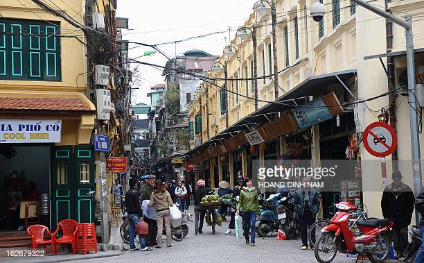 People walk on a newly renovated old street in the popular tourist ancient quarter of Hanoi in January 5 2012 Vietnam has received in the last year...