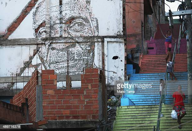 People walk on a staircase in the Providencia community or favela on September 23 2015 in Rio de Janeiro Brazil The historic favela is considered the...