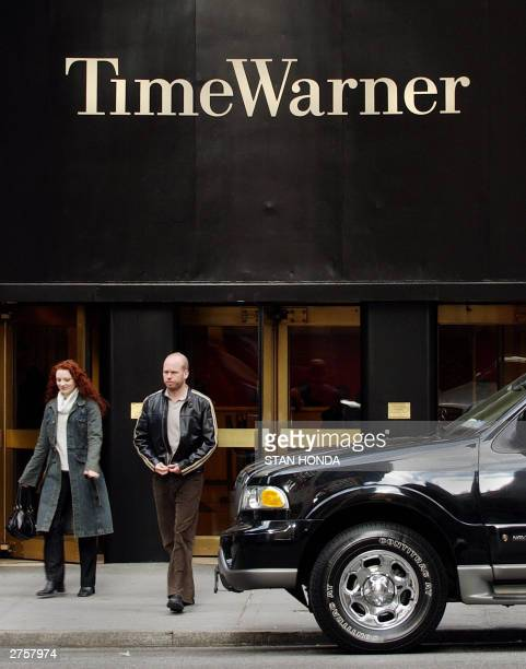 People walk on a street before Time Warner headquarters 24 November 2003 in New York Canadian tycoon Edgar Bronfman and a group of investors snagged...