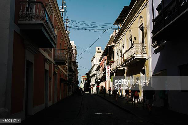 People walk on a street in Old San Juan Puerto Rico on on Tuesday July 7 2015 Governor Alejandro Garcia Padilla said in a televised speech June 29...