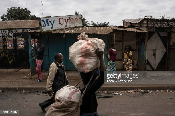 People walk on a street that was shut down by police the day prior in the Kibera slum on August 13 2017 in Nairobi Kenya A day prior demonstrations...
