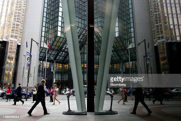 People walk on Bay Street in the financial district of Toronto Ontario Canada on Wednesday July 18 2012 The Bank of Canada said consumers and...