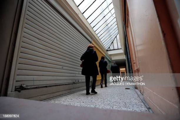 People walk on December 15 2012 in Paris through an empty 'Passage SainteAnne' near SainteAnne street Paris typical passages were built during the...