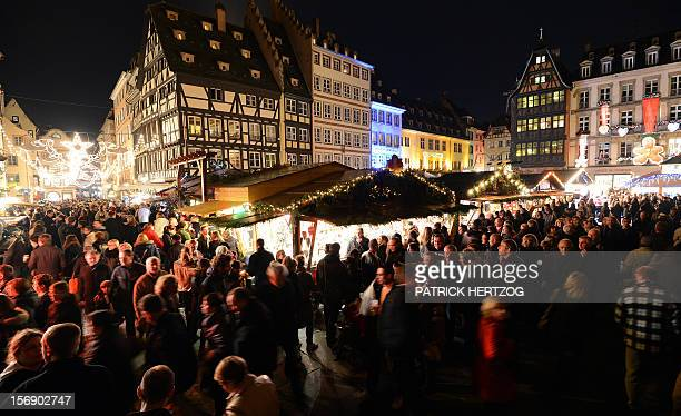 People walk on November 24 2012 in Strasbourg eastern France on the opening day of the city's Christmas market the largest and one of the eldest...