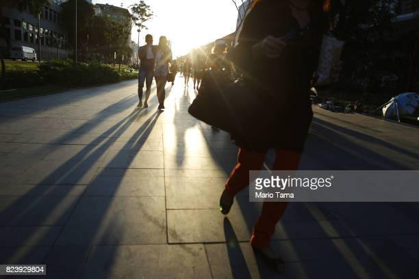 People walk on 'Olympic Boulevard' in the port district on July 21 2017 in Rio de Janeiro Brazil The revitalized port area has been heralded by...