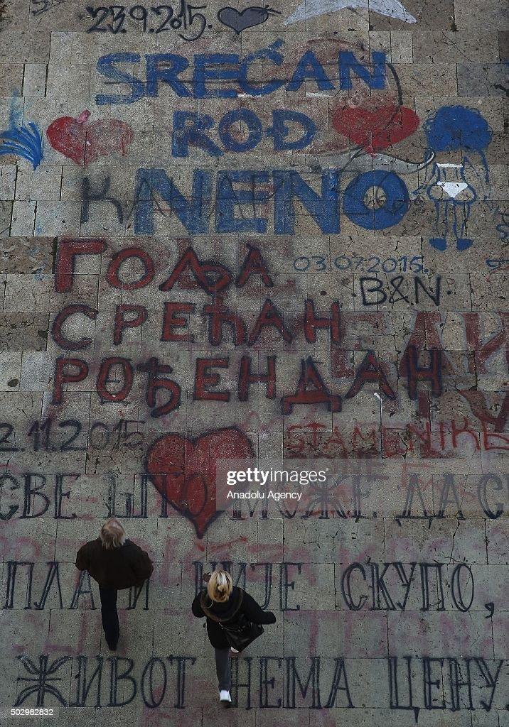 People walk on painted roads in Belgrade, Serbia on December 31, 2015.