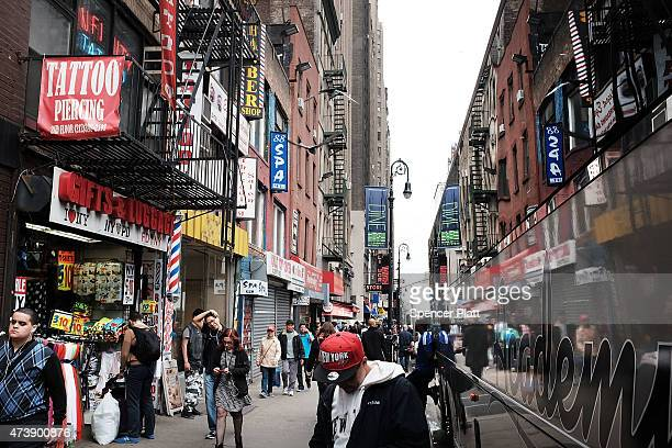 People walk on part of Eighth Avenue in Manhattan on May 18 2015 in New York City As many parts of once seedy New York City have been transformed...