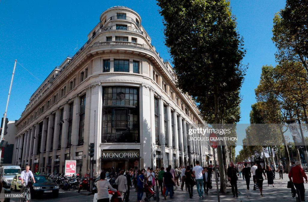 People walk on September 24 2013 past the ChampsElysees store of French suparmarket chain Monoprix in Paris French cosmetics maker Sephora said on...