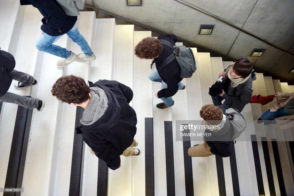 People walk on subway stairs turned into a musical keyboard on February 7, 2013 in Rennes, western France. For each step a musical note sounds, turning walk into melody. This device, set by 'les jardins numériques' is available until next Sunday. Car firm Volkswagen did this in Stockholm in 2009.