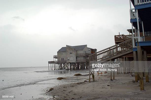People walk on the beach of North Topsail near the water September 15 2005 in North Topsail North Carolina Several of the houses in North Topsail are...