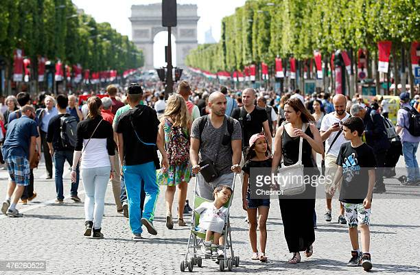 People walk on the Champs Elysees avenue made in to a pedestrian walkway on June 07 2015 in Paris France The most famous avenue in the world has been...