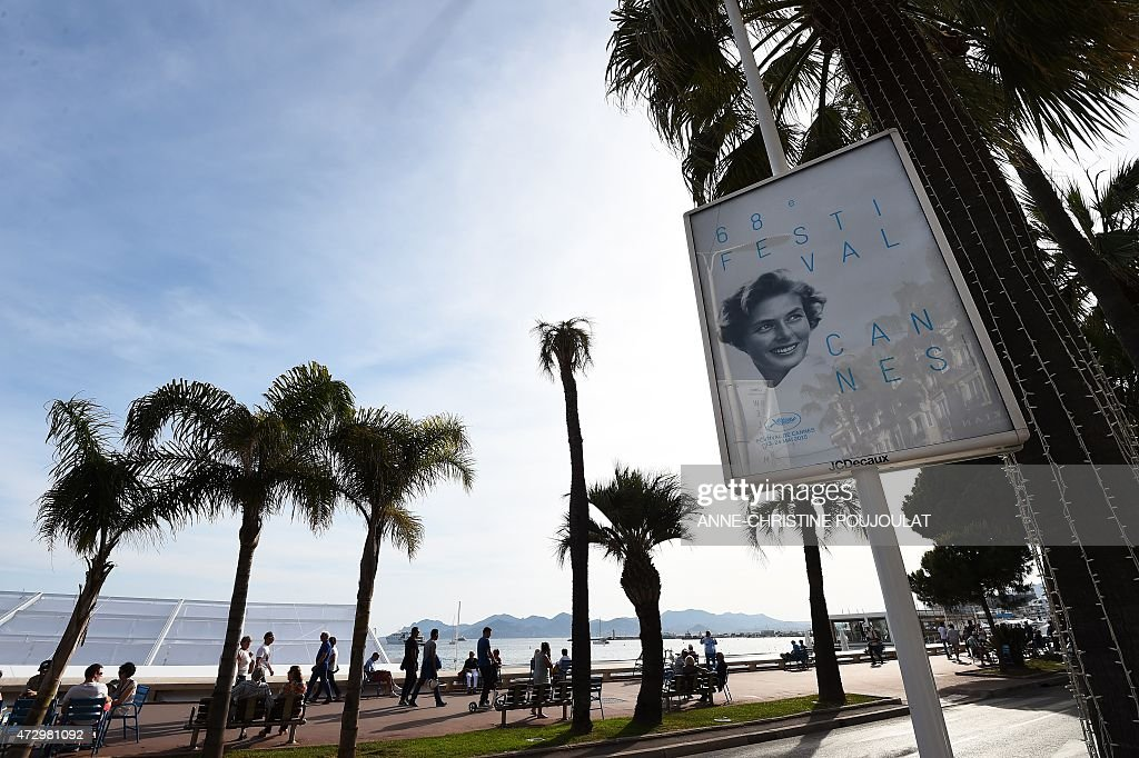 People walk on the Croisette before the 68th Cannes' film festival on May 11 2015 in Cannes southeastern France AFP PHOTO / ANNECHRISTINE POUJOULAT