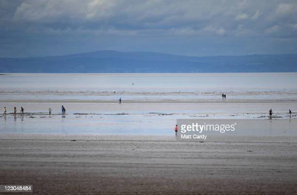 People walk on the near deserted beach on August 30 2011 in WestonSuperMare England According to weather experts the UK's summer has been one of the...