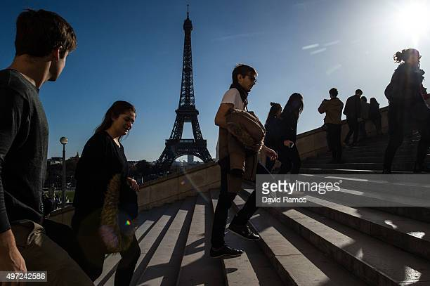People walk on the stairs of Trocadero with the Eiffel Tower on the background on November 15 2015 in Paris France As France observes three days of...