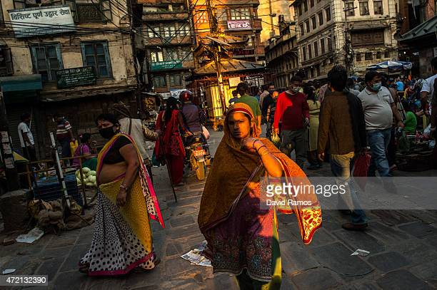People walk on the street on May 4 2015 in Kathmandu Nepal A major 79 earthquake hit Kathmandu midday on Saturday 25th April and was followed by...