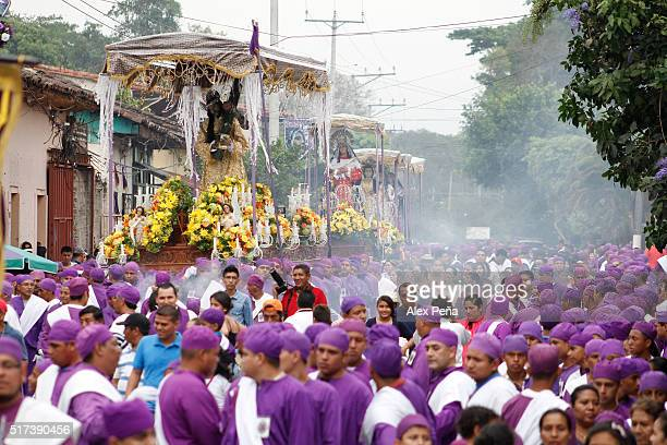 People walk on the streets during The Procession of the Christs on March 24 2016 in Izalco El Salvador This procession is considered the largest in...