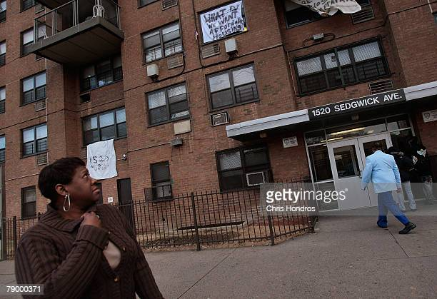 People walk out into 1520 Sedgwick Avenue a building considered by many to be the birthplace of the popular 'hip hop' style of music January 15 2008...