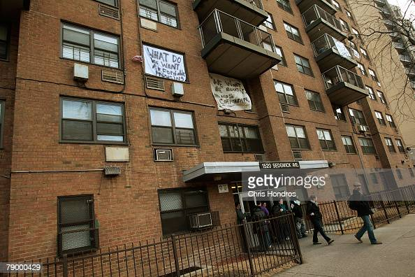 People walk out of 1520 Sedgwick Avenue a building considered by many to be the birthplace of the popular 'hip hop' style of music January 15 2008 in...