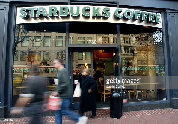 People walk out of a Starbucks coffee shop January 22 2004 in San Francisco California The Starbucks Corporation on January 21 posted a strong growth...