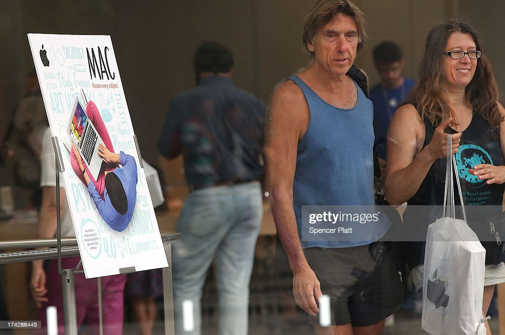 People walk out of an Apple store on July 23, 2013 in New York City. Apple is due to report third-quarter earnings after the markets close Tuesday. Apple, the California based technology company, has watched its stock sink to $427.68 a share from an all-time high of $702 last September. The company is under pressure to release a new blockbuster product.