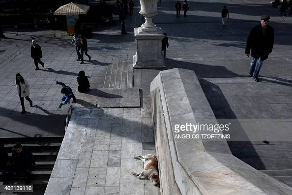 People walk outside a metro station at Syntagma Square in Athens as the nation goes to the polls on January 25 2015 Greece votes today in a crucial...