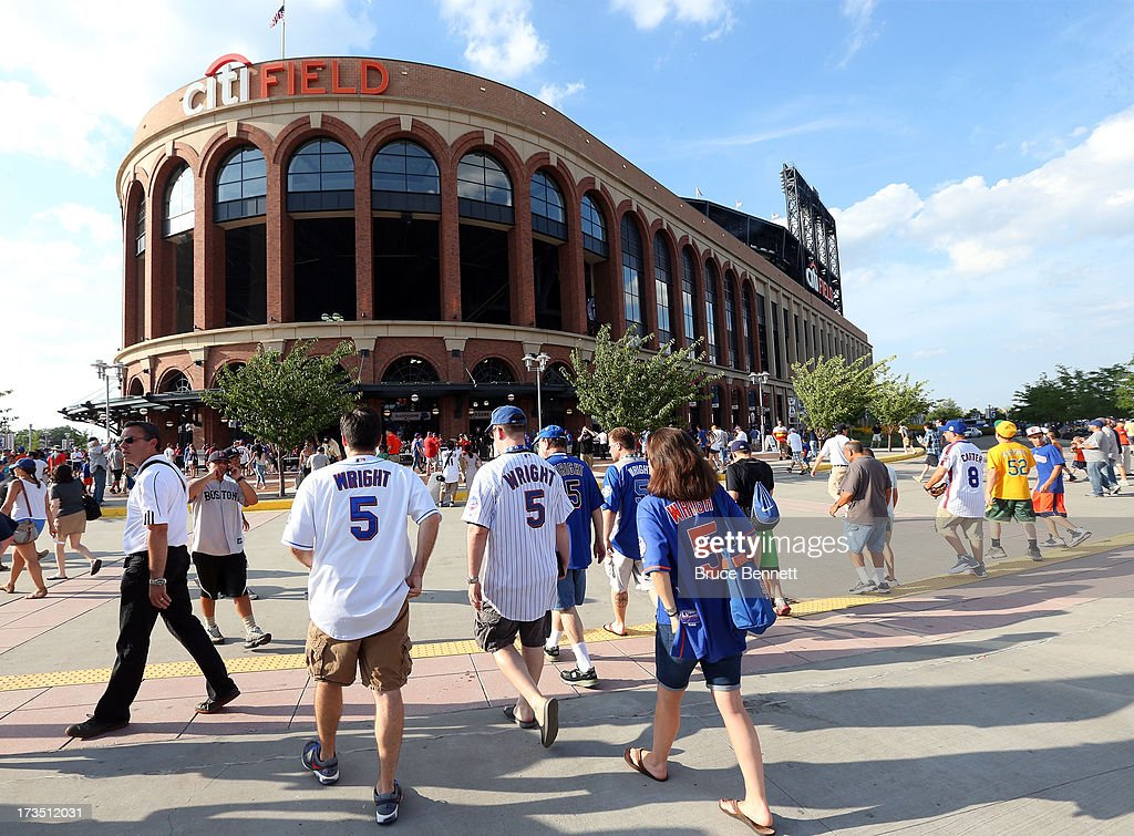 People walk outside of Citi Field during Gatorade All-Star Workout Day on July 15, 2013 in the Flushing neighborhood of the Queens borough of New York City.