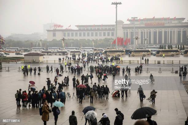 People walk outside the Great Hall of the People after the opening ceremony of the 19th National Congress of the Communist Party of China in Beijing...
