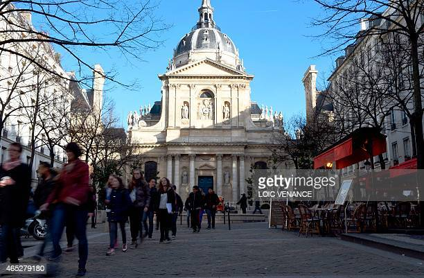 People walk outside the historical Sorbonne University in Paris on March 5 2015 AFP PHOTO / LOIC VENANCE / AFP PHOTO / LOIC VENANCE